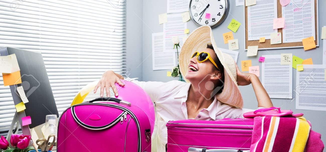 33142649-Smiling-female-office-worker-ready-to-leave-for-vacations-with--Stock-Photo